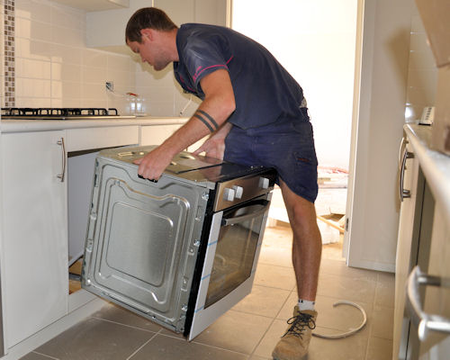 Electrician Installing an oven in cronulla home
