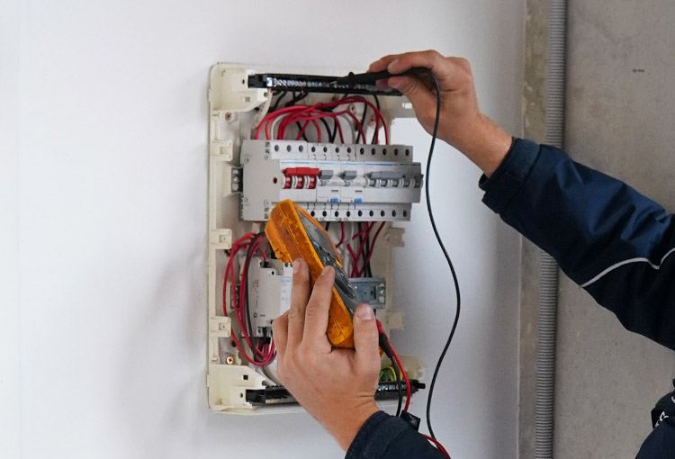 Electrician installing a new safety switch in sutherland shire